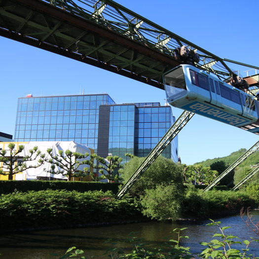The new blue suspension railway passes the Bayer AG plant.