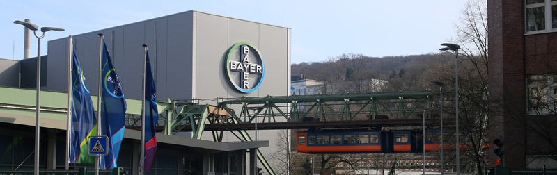The suspension railway passes the Bayer AG building.